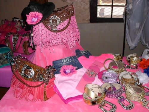 tough enough to wear pink purses, belts, and bling flowers for allie ollie rodeo season in prescott