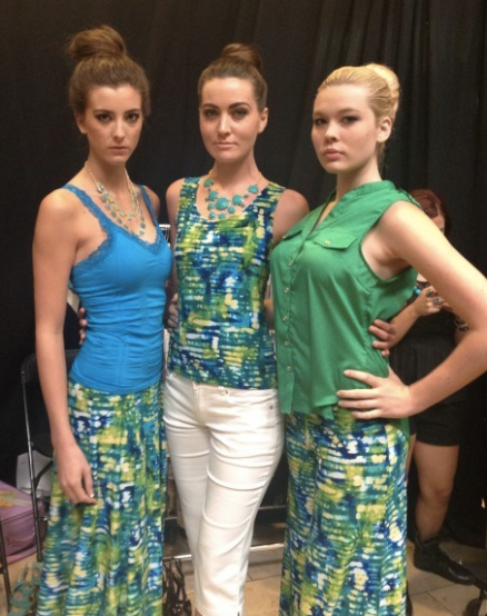 models vamping in green and blue outfits part of the allie ollie ensemble line