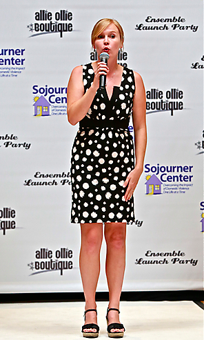 elise from the sojourner center talking on the runway for allie ollie fashion show