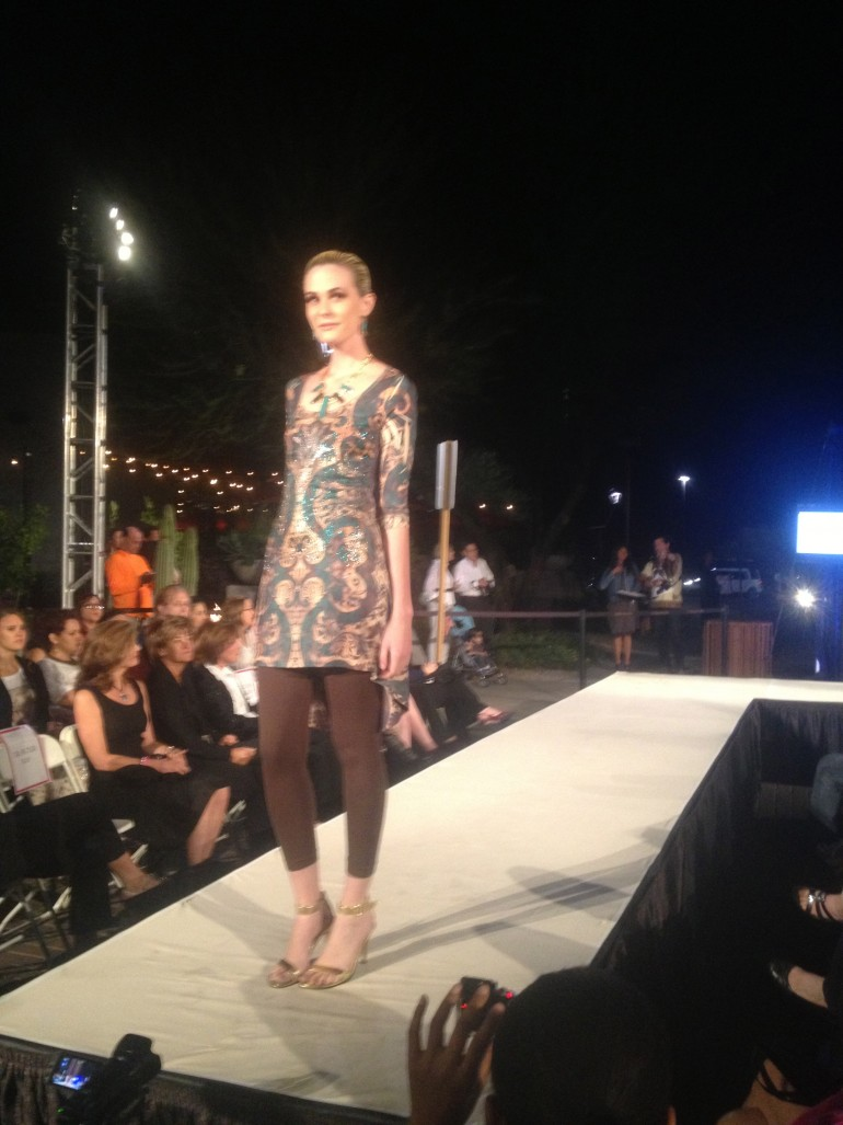 model wearing allie ollie emerald elegance high low tunic and brown leggings at tucson fashion week