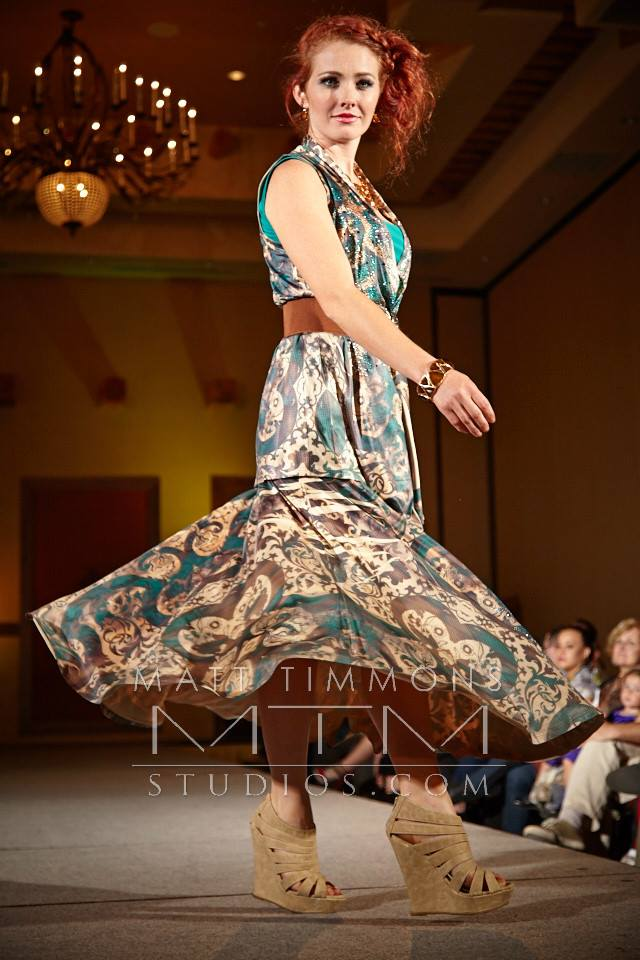 Allie Ollie Emerald Elegance spinning on the runway at Santa Fe Fashion Week