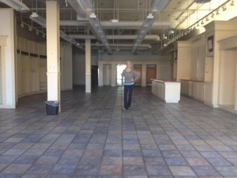 Owner of Allie Ollie Allie Olson Standing in Empty Boutique Space