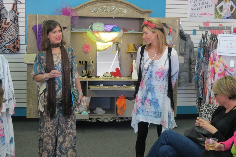 Allie Olson of Allie Ollie in tunic explaining Camp Soaring Eagles Makeovers for Moms Event